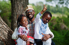 African Father With Kids In Tr...
