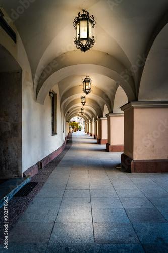 Obraz na plátně Arcades or archway with long corridor illuminated by vintage lanterns