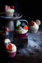 Cupcakes Vanilla With Fruits And Powdered Sugar