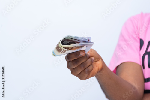 african woman stretches some money forward Canvas-taulu