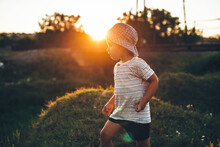 Small Boy Playing In A Field W...