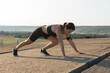 Young attractive woman doing exercise working out outdoors.