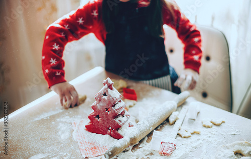 Caucasian girl preparing food for christmas holidays using a lot of flour on tab Poster Mural XXL
