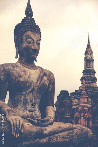 Fototapeta sukhothai Buddha statue with temple in Thailand