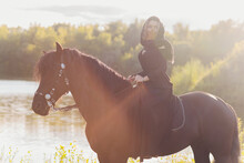 Muslim Woman In Hijab Riding A...