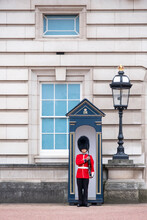 A Royal Guard Outside Buckingham Palace, Official Residence Of The Queen In Central London, London, England, United Kingdom