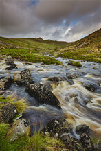 A Moorland River Rushes Downill Through A Valley, En Route From The Moors To The Sea, The River Tavy, In Dartmoor National Park, Devon, England, United Kingdom