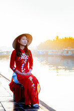A Young Asian Woman In A Red A...