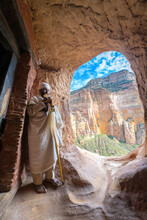 Ethiopian Orthodox Priest Holding The Hand Cross At Entrance Of Abuna Yemata Guh Church, Gheralta Mountains, Tigray, Ethiopia