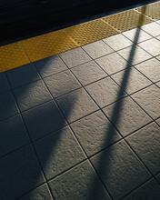 Sunlight And Shadow On Train Platform.