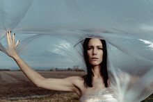Woman In Nature Covered With Plastic. Plastic Problem