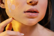 Sensual Young Lady With Glitter Makeup In Yellow Rays