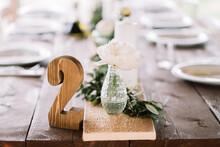 Wooden Number 2 On The Wedding Table