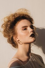 Blond Model With Black Lips An...