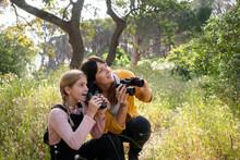 Mother And Daughter Using Binoculars