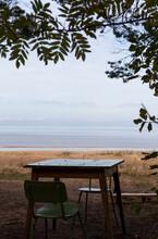 Table Overlooking The Lake. La...