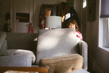 Child Playing With Cushions