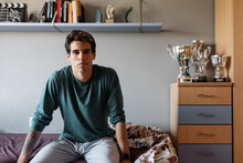 Young Sportsman Sitting On Bed...