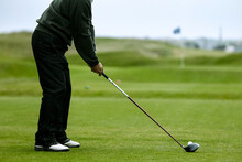 Anonymous Man Playing Golf