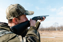 Adult Shooter Aiming At Cloudy Sky