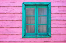 Pink And Green Window Of A Fac...