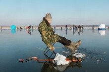 Male Angler During Ice Fishing...