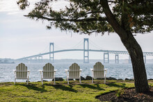 Adirondack Chairs And Newport Bridge In Newport, Rhode Island