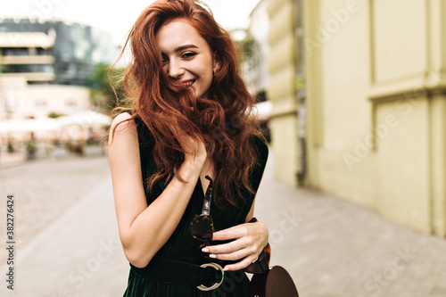 Fototapety, obrazy: Curly lady smiling and walking through city