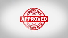 Insurance Claim Approved Signed Stamping Text Wooden Stamp Animation. Red Ink On Clean White Paper Surface Background With Green Matte Background Included.
