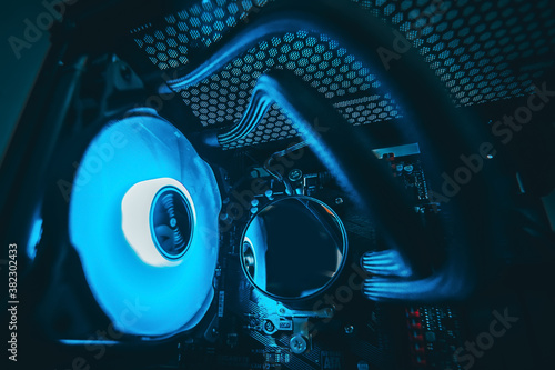 Close up shot.Computer with water cooling system.Inside of air cooled high performance modern.Blue and Red LED