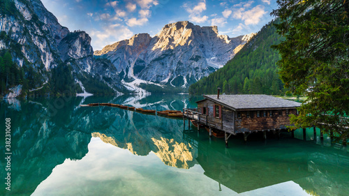 Lake Braies (Lago di Braies) in Dolomites Mountains, Boat hut on Braies Lake with Seekofel mount on background, Sunrise of Italian Alps, Naturepark Fanes-Sennes-Prags, Dolomite, Italy, Europe.