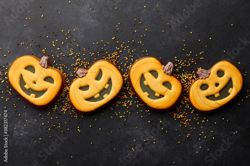 Foto Funny Halloween gingerbread biscuits on black background