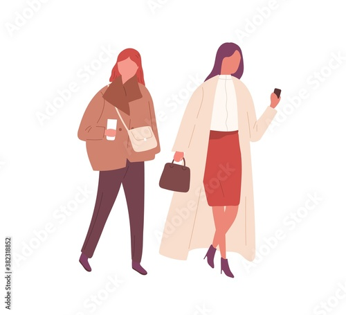 Female friends in stylish outwear walking together outdoors. Trendy young women hold phone and drink coffee. Flat vector cartoon illustration isolated on white.