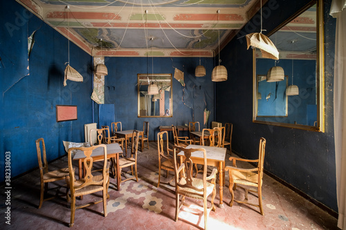Fényképezés dining room with wooden table and chairs in abandoned house