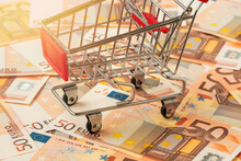 Grocery Cart With Euro Currency Background