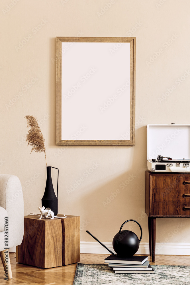 Fototapeta Design scandinavian home interior of living room with mock up poster map, stylish wooden commode, cube, flower in vase and elegant accessories. Beige wall. Modern home staging. Template. Japandi.