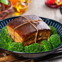 Dong Po Rou (Dongpo Pork Meat) In A Plate With Green Vegetable, Traditional Festive Food For Chinese Lunar New Year Cuisine Meal, Close Up.