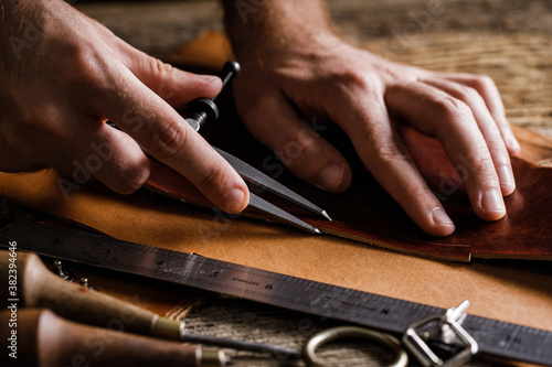 Close up of a shoemaker or artisan worker hands Wallpaper Mural