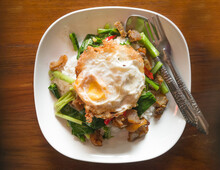 Stir Fried Chinese Kale With Belly Crispy  Pork And Fried Egg On Rice