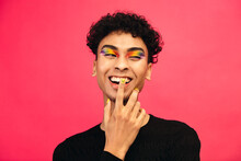 Smiling Gay Man With Rainbow Eye Shadow And Smiley Nailpaint