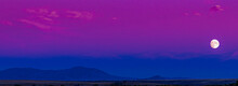 Landscape Of An Amazing Colorful Blue And Pink And Magenta Moonscape Moon Rise During Blue Hour Of A Sunset In Montana With A Silhouette Of The Highwood Mountains