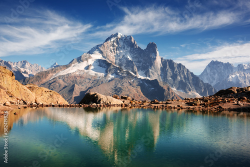 Fotografie, Obraz Incredible view of clear water and sky reflection on Lac Blanc lake in France Alps