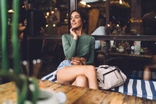 Thoughtful Woman In Cozy Cafe