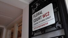 The Floral Court Address Sign Next To The Building Entrance