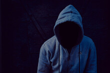 Closeup Shot Of A Man In A Hoodie With No Visible Face