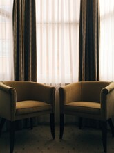 Two Chairs And A Bay Window