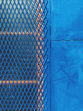 Protective Metal Screen Covering Window On Building Wall, Close Up