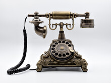 Vintage Telephone In Bronze Color With White Background