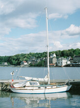 Small Yacht Moored In Bay
