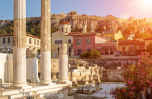 Hadrian`s Library Overlooking Famous Acropolis At Sunset, Athens, Greece. Sunny View Of Ancient Greek Ruins At Plaka District.